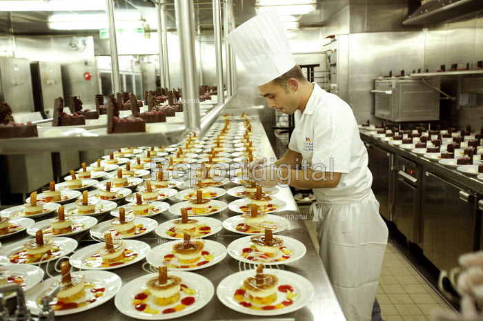 The Aurora cruise ship, a P&O cruise ship. The Irish sous chef at work in the kitchen.. - Paul Box - 2004-06-02