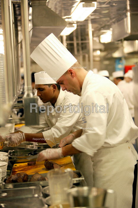 The Aurora cruise ship, a P&O cruise ship. An Indonesian chef at work in the kitchen.. - Paul Box - 2004-06-02