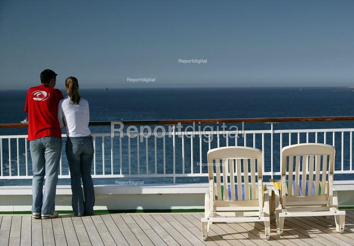 The Aurora cruise ship, a P&O cruise ship. A young couple look out to sea - Paul Box - 2004-06-02