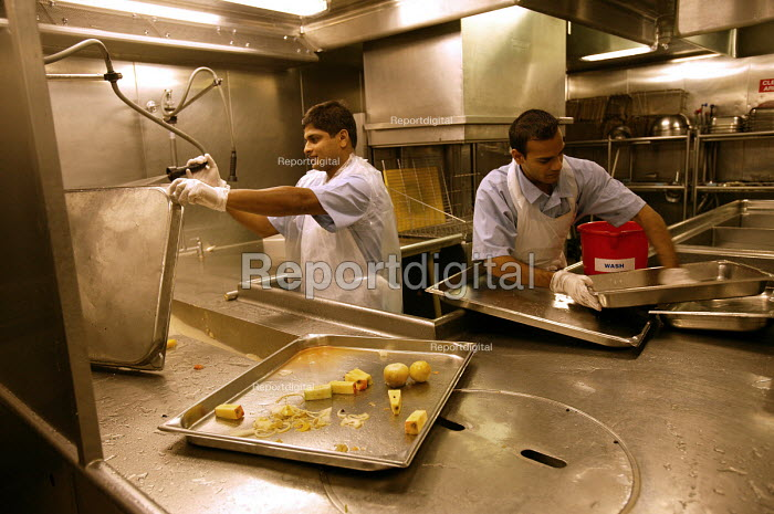 The Aurora cruise ship, a P&O cruise ship. Indonesian workers wash the pans. - Paul Box - 2004-06-02