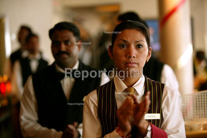 The Aurora cruise ship, a P&O cruise ship. Indonesian waitress appludes a speech. - Paul Box - 2004-06-02