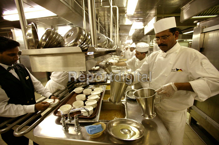 The Aurora cruise ship, a P&O cruise ship. Indonesian chef works in the kitchen. - Paul Box - 2004-06-02