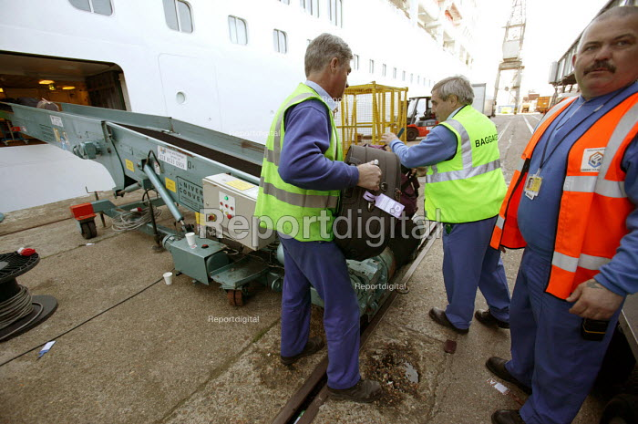The Aurora cruise ship, a P&O cruise ship. Baggauge handlers load guests suitcases. - Paul Box - 2004-06-02