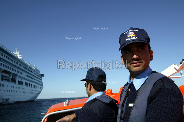 The Aurora cruise ship, a P&O cruise ship. Indonesian workers on the tender. - Paul Box - 2004-06-02