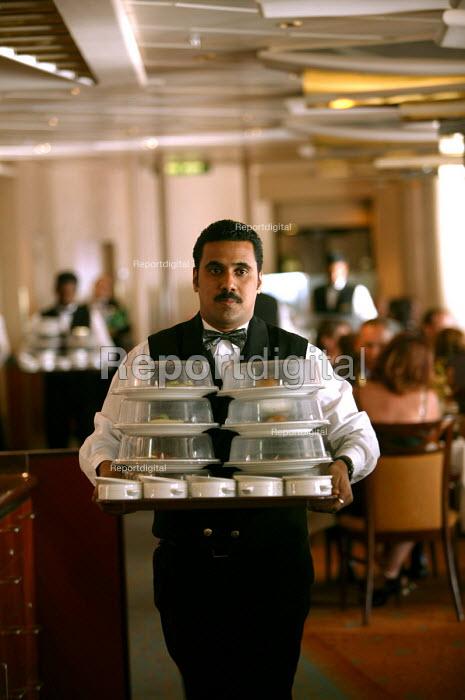 The Aurora cruise ship, a P&O cruise ship. Indonesian waiter at work. - Paul Box - 2004-06-02