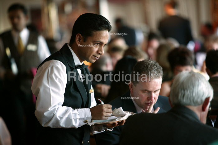 The Aurora cruise ship, a P&O cruise ship. Indonesian waiter takes a food order. - Paul Box - 2004-06-02