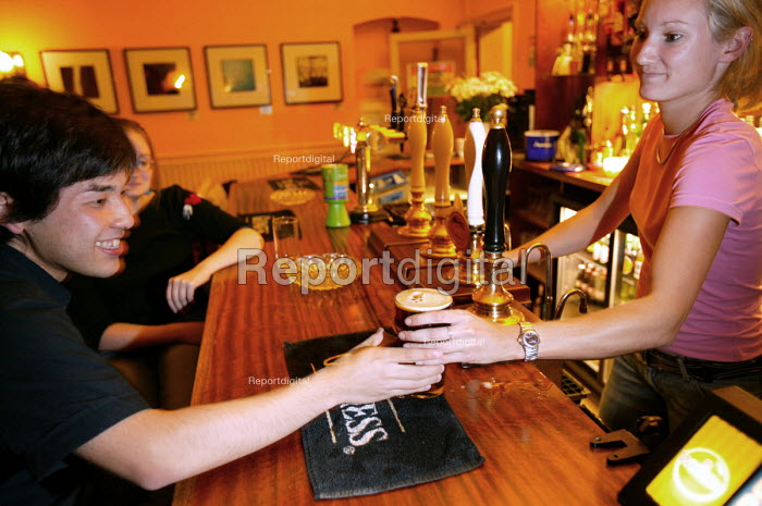 A student drinking in his local pub, Bristol. - Paul Box - 2004-06-02