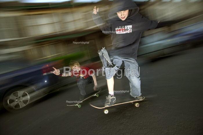 Boys skateboard in the street, Bristol. - Paul Box - 2004-08-02