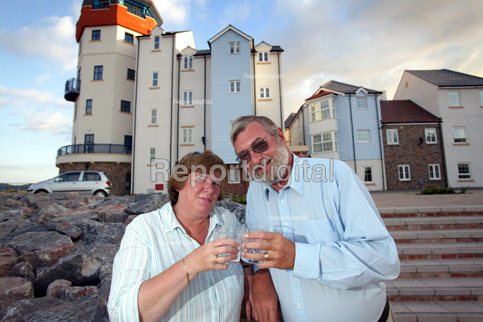 A middle aged couple who have moved into luxury coastal development, Portbury , Nr Bristol. - Paul Box - 2004-09-01