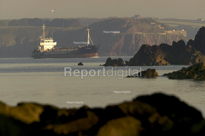 An oil tanker in Milford Haven carrying crude oil to the Texaco oil refinery, Rhoscrowther Pembroke Dock. Pembrokeshire. - Paul Box - 2004-08-02