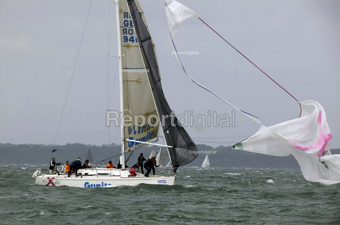 A yacht has its sail ripped out. Charter yacht sailing, Cowes week Regatta, Isle of Wight - Paul Box - 2005-12-05