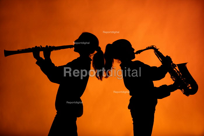 Pupils playing a saxophone and a clarinet in a music... - Paul Box, PB608074.jpg