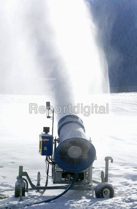 Snowmaking machine , Alps. The machine blows water through a fine mesh which freezes if the temperature is below freezing, producing snow on the pistes for the skiers. - Paul Box - 2007-01-20