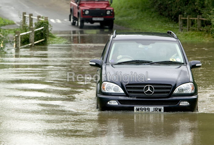 A four wheel drive vehicle drives through flood water... - Paul Box, PB707012.jpg