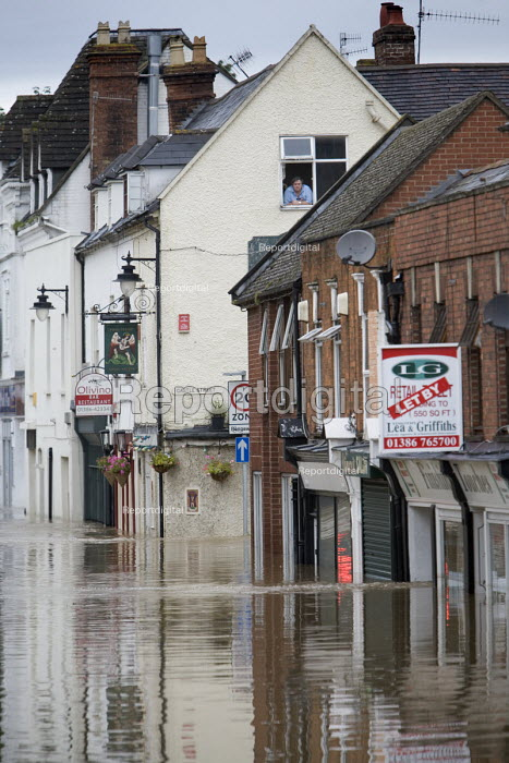 A local resident looks out on a flooded high street in... - Paul Box, PB707066.jpg