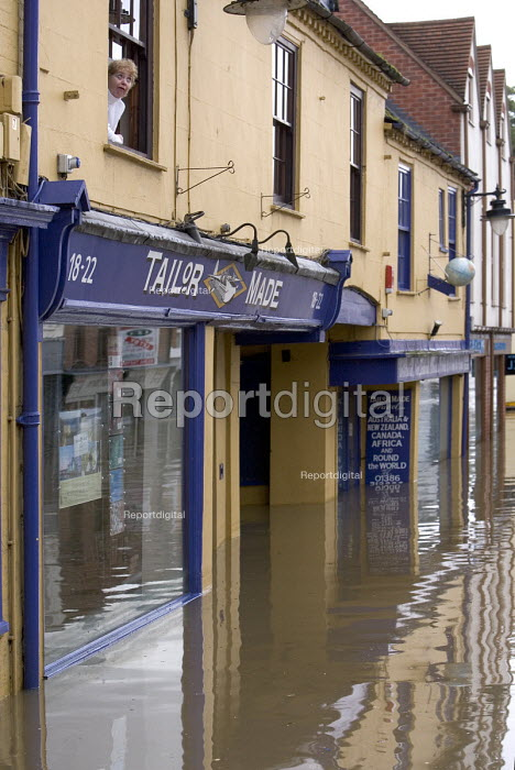 A local resident looks out on a flooded high street in... - Paul Box, PB707071.jpg