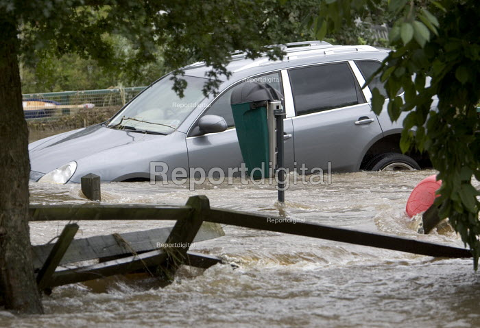 A Porsche Cayenne is submerged in flood water after the... - Paul Box, PB707079.jpg