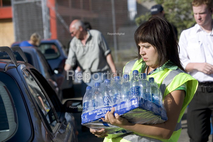 Gloucester, Volunteers distribute drinking water to people... - Paul Box, PB707124.jpg