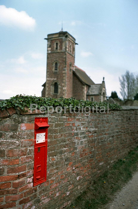 Letterbox in the village of Holtby, Yorkshire. - Philip Wolmuth - 2003-04-21