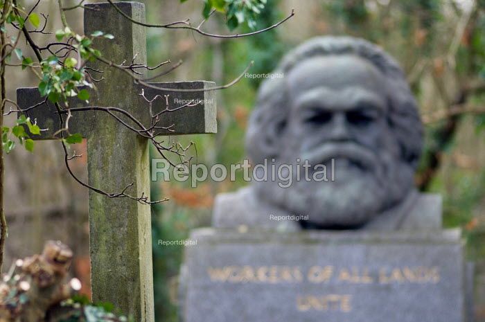 A cross on a grave opposite the tomb of Karl Marx... - Philip Wolmuth, pw070124.jpg