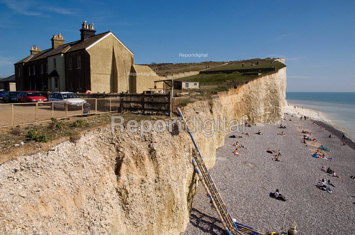 Surviving cottages in a terrace partly lost to coastal erosion of the chalk cliffs in the village of Birling Gap, East Sussex. - Philip Wolmuth - 2007-04-08