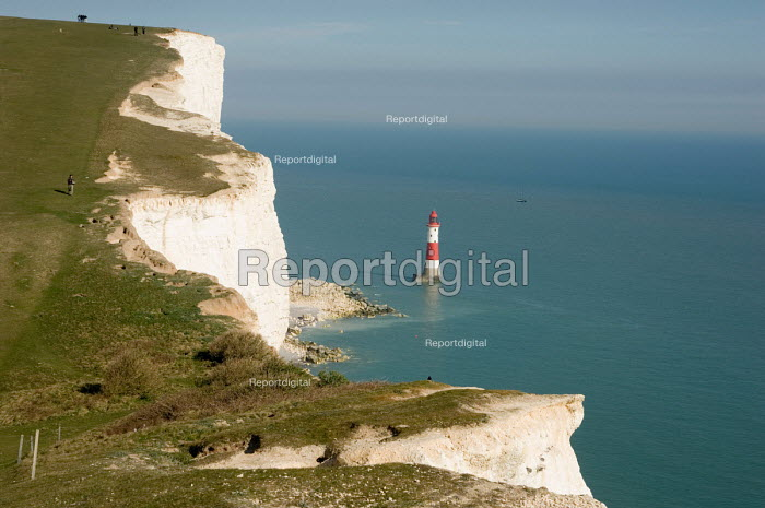 Lighthouse at Beachy Head and walkers on the South Downs Way, East Sussex. - Philip Wolmuth - 2007-04-08
