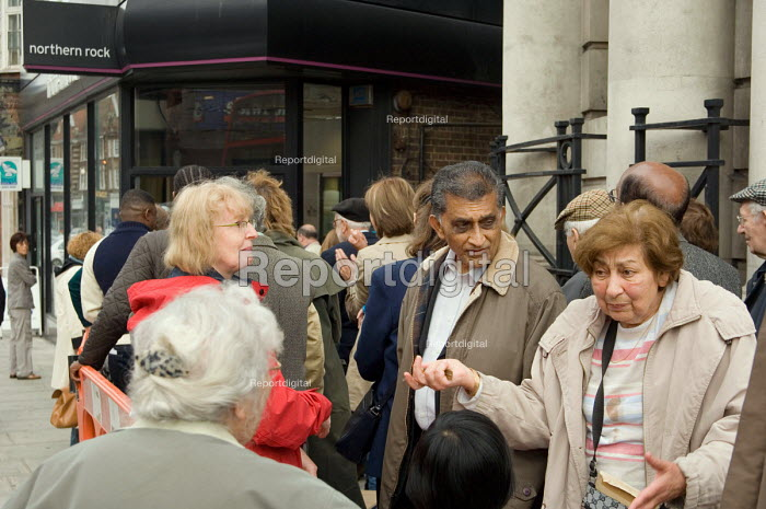 Depositors queue to withdraw their savings from a branch... - Philip Wolmuth, pw070922.jpg