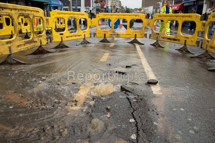 Burst water main in West End Lane, West Hampstead, London... - Philip Wolmuth, pw071004.jpg