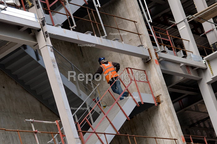 A construction worker on the site of a new office... - Philip Wolmuth, pw080130.jpg