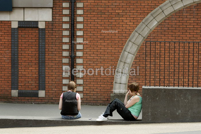 Bored teenagers sit on a wall in Walsall town centre, West... - Philip Wolmuth, pw080921.jpg