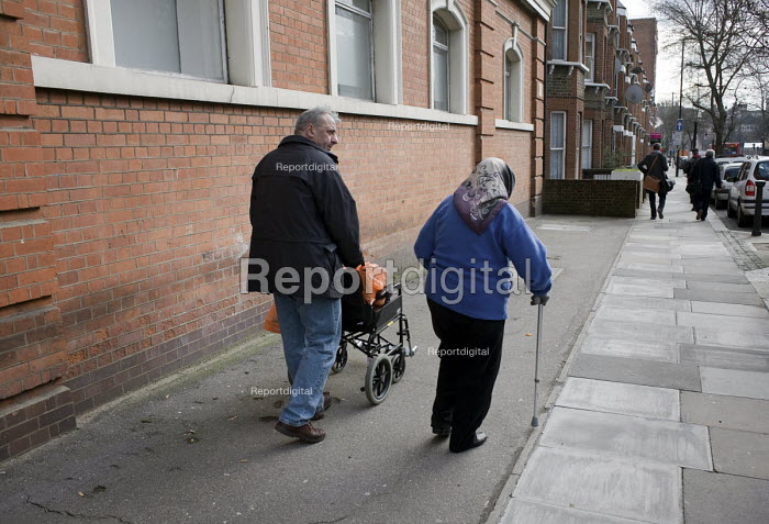 Elderly couple with a wheelchair and walking stick - Philip Wolmuth, pw090236.jpg