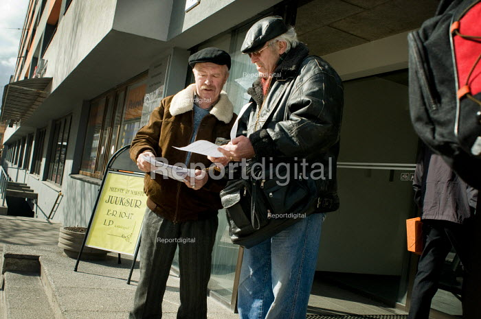 Two unemployed men look at printouts of job vacancies... - Philip Wolmuth, pw0909077.jpg