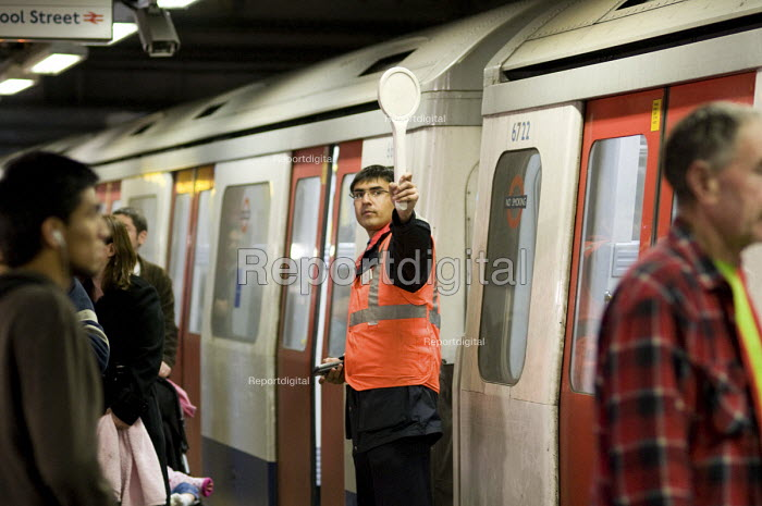 A train guard signals to a driver on the London underground. - Philip Wolmuth - 2009-10-29