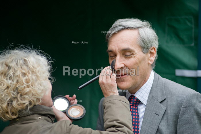 Conservative John Redwood MP is made-up before being interviewed by Sky News on College Green, Westminster, 2010 General Election. - Philip Wolmuth - 2010-05-11