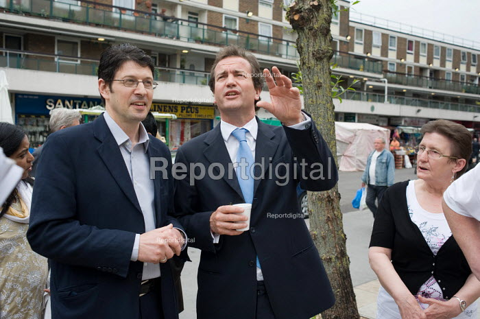 Conservative MP Nick Hurd talks with Neighbourhood Manager Marco Torquati during a visit t0 projects in Church Street, London, supported by the Paddington Development Trust. - Philip Wolmuth - 2010-05-20