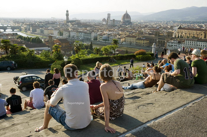 Young people on a terrace overlooking the River Arno and the landmark Duomo, Florence, Italy. - Philip Wolmuth - 2010-06-05