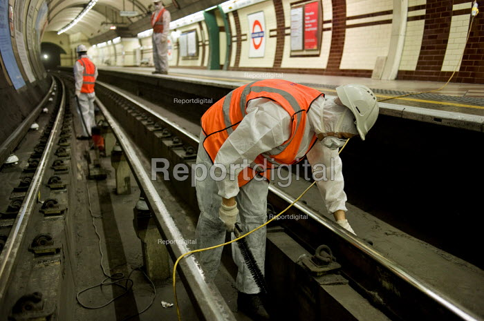 Deep Cleaning Gang employed by a sub-contractor Initial Transport Services working through the night at Edgware Road tube station on the Bakerloo Line. The track in the station and 50 metres into each tunnel are cleaned every two weeks to prevent an accumulation of debris. - Philip Wolmuth - 2010-05-28