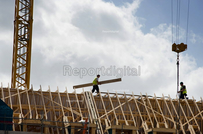 Construction workers on the roof of a new housing development in Maningtree, Essex - Philip Wolmuth - 2010-07-15