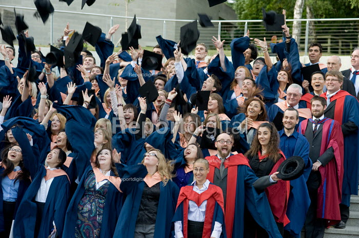 University of East Anglia (UEA) students pose for their graduation photograph. Throwing their hats in the air. - Philip Wolmuth - 2010-07-15
