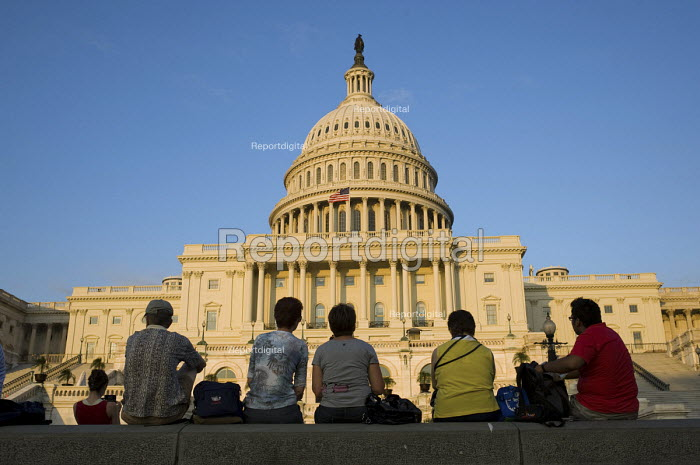 Tourists sitting outside The Capitol building, Washington D.C., where Congress presides. The US Congress is the bicameral legislature of the federal government of the USA, consisting of the Senate and the House of Representatives. - Philip Wolmuth - 2010-07-27