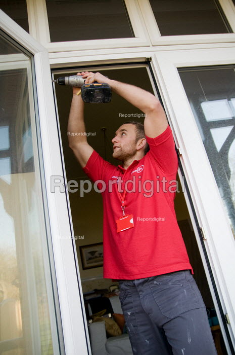 Connaught maintenance staff at the home of a housing association tenant in West London using screwdriver on door hinges. - Philip Wolmuth - 2008-11-25