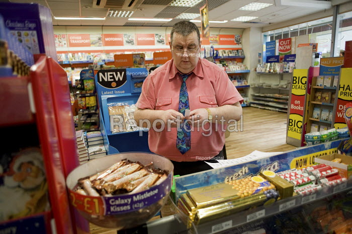 A Job Seekers Allowance claimant on a compulsory four week unpaid work placement in a branch of WH Smith in Middleton, Rochdale, part of a Mandatory Work Related Activity welfare-to-work programme. - Philip Wolmuth - 2010-10-07