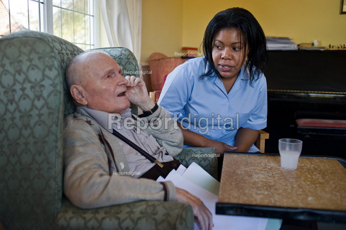 A Job Seekers Allowance claimant on a compulsory four week unpaid work placement in a private care home in Middleton, Rochdale, part of a Mandatory Work Related Activity welfare-to-work programme. - Philip Wolmuth - 2010-10-07