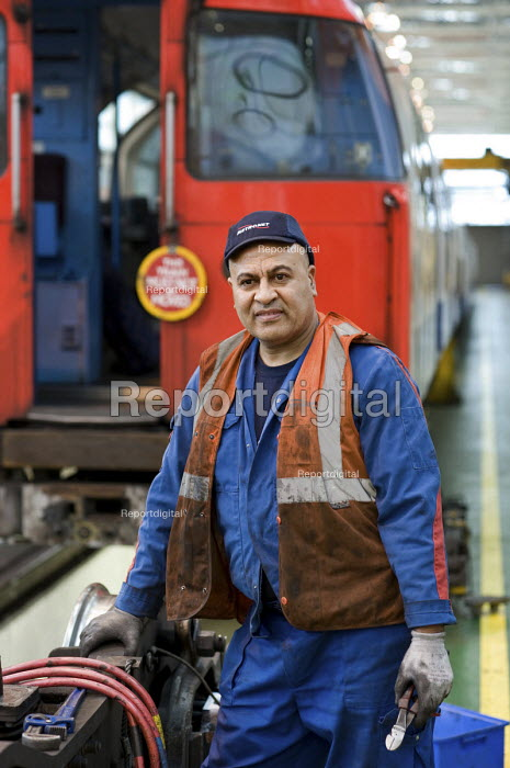 Worker at London Underground Northumberland Park Depot which services the 42 tube trains on the Victoria line - Philip Wolmuth - 2009-12-03