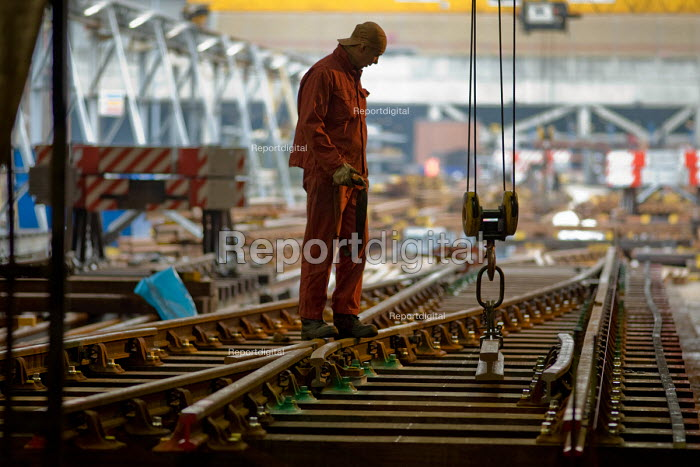 A worker in the Points and Crossings Shed of London Underground's Lillie Road Depot. The depot produces replacement track for the tube network and offers a same day service for urgent repairs and replacements. The depot is now run by London Underground after PPP contractor Metronet entered administration in 2007. - Philip Wolmuth - 2010-01-27