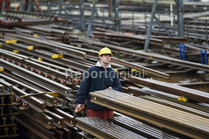 A worker in the Points and Crossings Shed of London Underground's Lillie Road Depot. The depot produces replacement track for the tube network and offers a same day service for urgent repairs and replacements. The depot is now run by London Underground after PPP contractor Metronet entered administration in 2007. - Philip Wolmuth - 2010-02-16