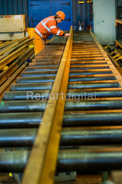 A worker in the Points and Crossings Shed of London Underground's Lillie Road Depot prepares to bend a replacement rail to match a curve in the track. The depot produces replacement track for the tube network and offers a same day service for urgent repairs and replacements. The depot is now run by London Underground after PPP contractor Metronet entered administration in 2007. - Philip Wolmuth - 2010-02-16