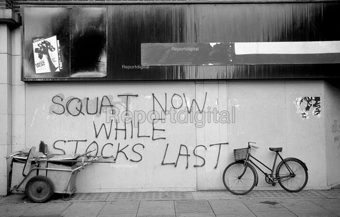 1976: squatting graffiti on Westbourne Grove. Notting Hill, West London. Squat whilst stocks last - Philip Wolmuth - 1976-03-01
