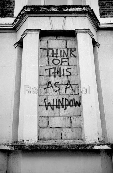 1976 Graffiti on a bricked-up empty council owned property in Westbourne Park Road, West London. A number of empty houses in the street were occupied by squatters. Think of this as a window. - Philip Wolmuth - 1976-03-01