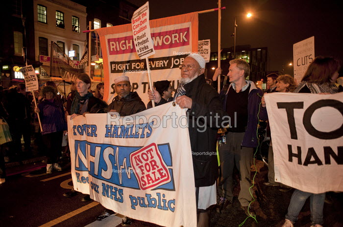 Demonstrators block Whitechapel Road during a protest against cuts at Barts and the London NHS Trust, Royal London Hospital, Whitechapel. - Philip Wolmuth - 2011-02-11